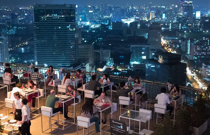 Image of rooftop bar and skyline.