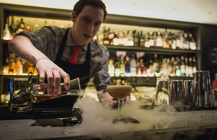 Image of bartender mixing up cocktails.