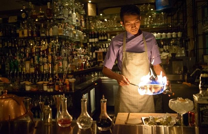 Image of bartender preparing cocktails.