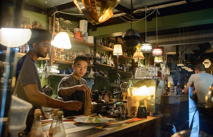 Image of bartenders behind the desk.