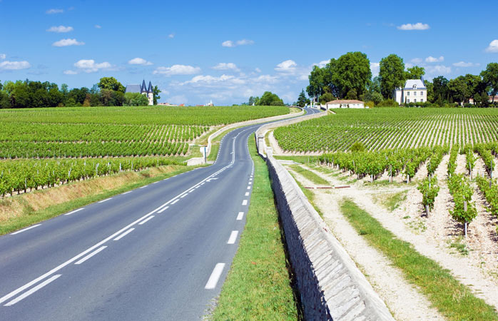 Follow the road through rolling vineyards to Château La Gravière in Médoc wine country