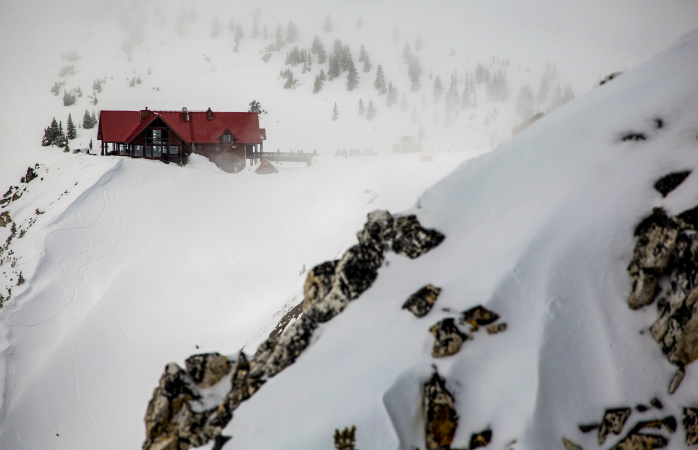 Ski and stay atop the mountains in a wilderness lodge