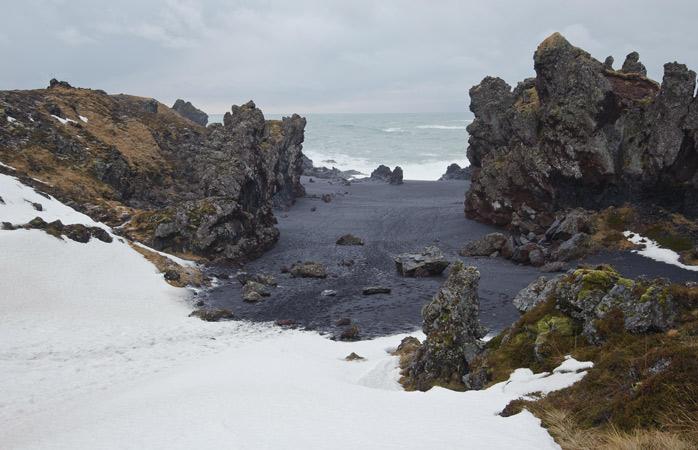 The black-sand beach Djúpalónssandur looks a tiny bit haunting thanks to the peculiar rock formations