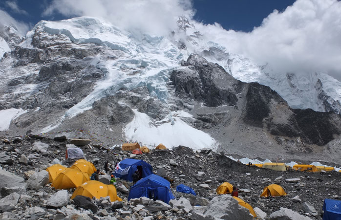 At the high altitude at Base Camp, set up a tent and rest to adjust