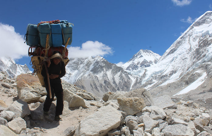 Sherpas that know the mountain by heart will help you carry the heaviest of your equipment