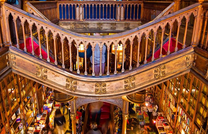 Customers browse through books at the Lello Library, a Neo-gothic bookstore in Porto © guillenperez