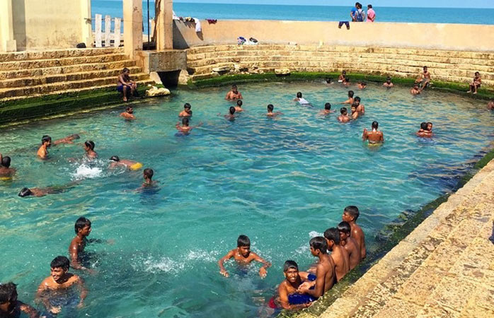 Kids swimming in Keerimalai Hot springs