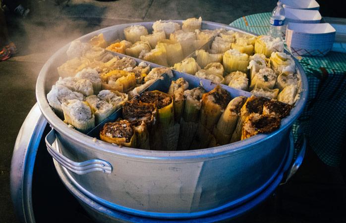 Enjoy a Christmas dinner consisting of 'tamales' in Venezuela