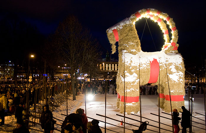People overlooking the Gävle Goat in Sweden, just moments before it's set ablaze