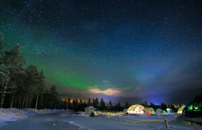 Gaze up at the unending Aurora Borealis at Hotel Kakslauttanen
