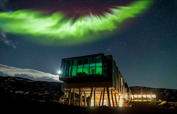 The Aurora Borealis shines over the ION Hotel.