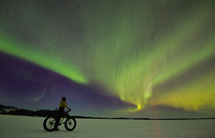 Grab a fat tire bike from Blachford Lake Lodge and pedal under the Northern Lights