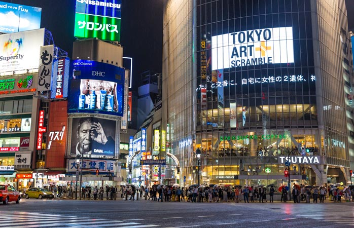 Watch the world go by at the famous Shibuya Scramble Crossing
