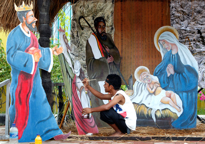 Locals build Christmas nativity scenes from recycled materials in Timor Leste