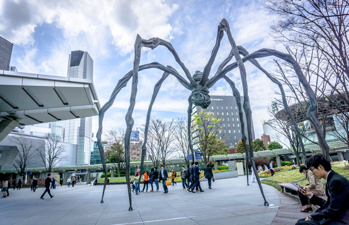The famous spider sculpture Maman standing tall in front of Mori Tower in Roppongi Hills