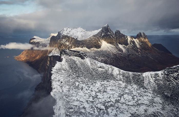 If you're up for the challenge, hike all the way to the summit of Segla