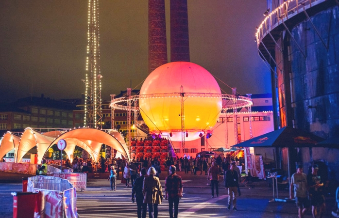The glowing orb and power plant at Helsinki's Flow Festival.